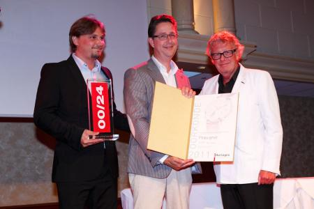 Pierre Leibundgut, the brand's CEO, and Raymond de Greef, Pequignet's Netherlands representative with Jan des Bouvrie.