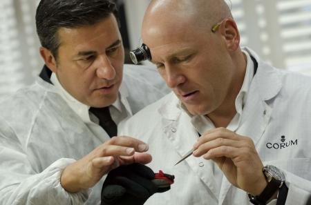 Antonio Calce - CEO of Corum - and Didier Cuche admiring the work of the watchmakers of the House.