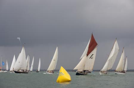 Competitors faced challenging 20 knot plus breezes as well as contrastingly light and capricious winds.