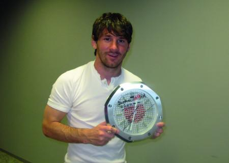 Leo Messi Argentine football player with the clock that he has signed for