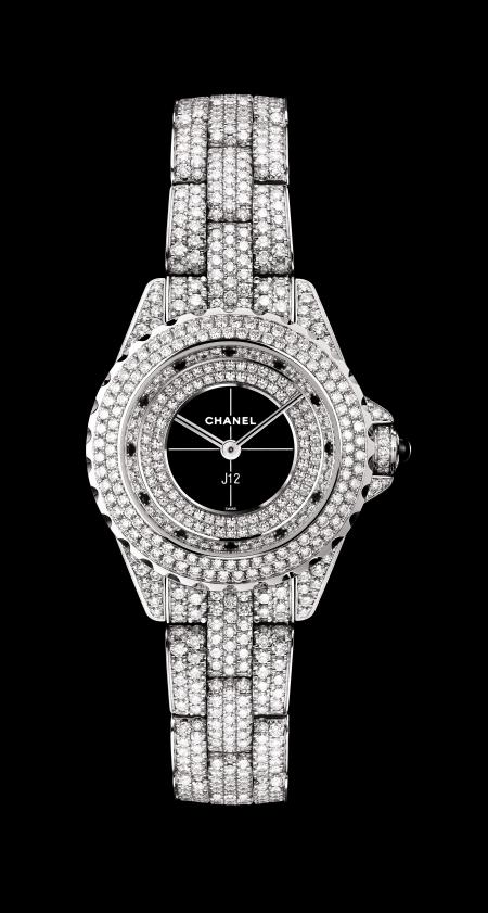Chanel - J12 29mm watch in white gold set with diamonds.