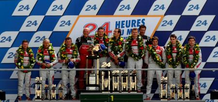 The Audi Sport Team on the highest steps of the Le Mans podium.
