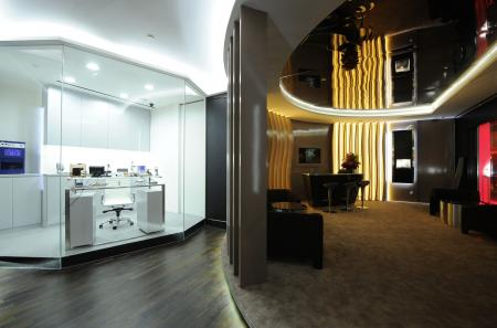 The watchmakers' workshop and the lounge bar of the Richard Mille boutique at the Grand Hyatt Singapore.