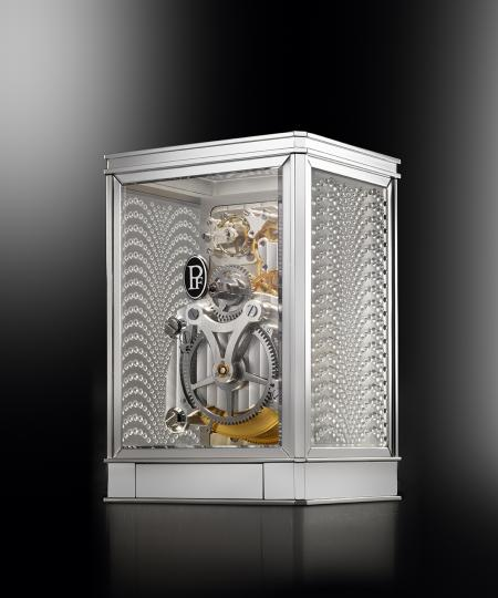 The clock 15 days Lalique - Parmigiani Fleurier, in white. Backside view.