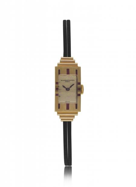 Art Déco 1939 - Lady's wristwatch, 18K pink gold, baguette?cut and square?shaped rubies. Gilt polished dial, double cord strap. N° 11087