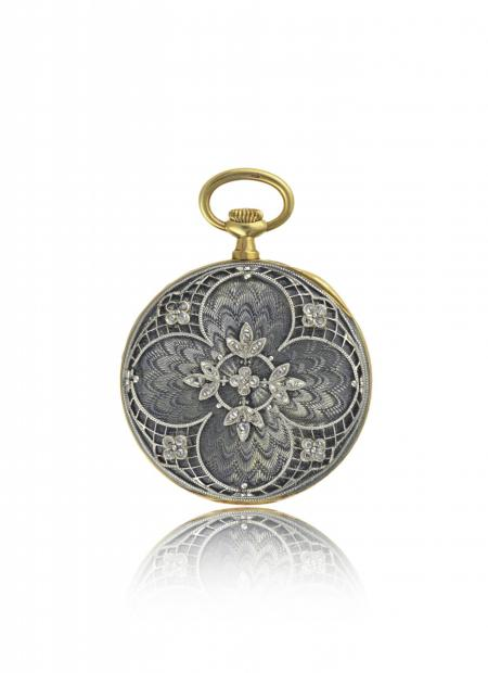 France 1909 - Lady's pendant watch, yellow gold, translucent enamel on guilloché back, platinum and diamond floral? pattern appliques. Silvered dial.