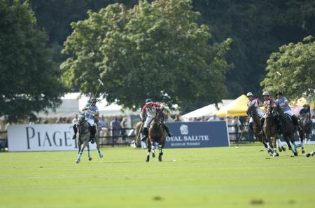 Facundo Pieres of Argentina battles for the ball against Luke Tomlinson of England - ©Nick Harvey