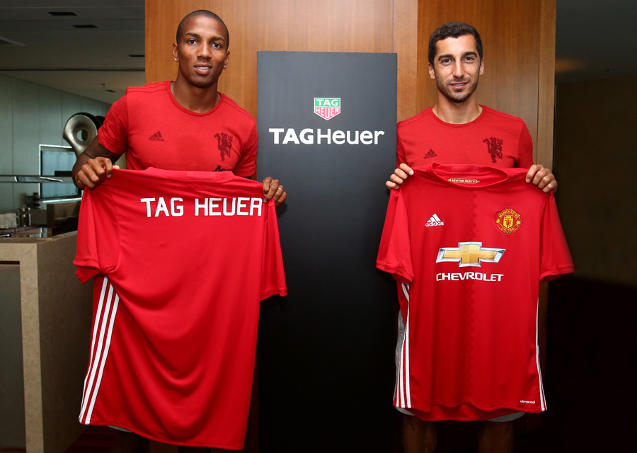 Ashley Young and Henrikh Mkhitaryan show off TAG Heuer branded jersey