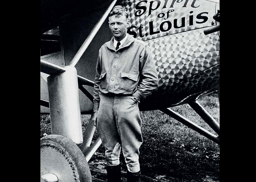 Charles Lindbergh in front of The Spirit of St. Louis